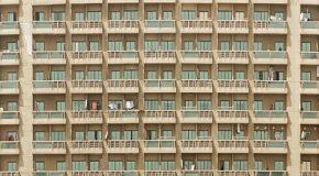 Achat de logements HLM : différé du paiement des charges de copropriété